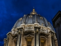 A dome on the roof of the st peters basilica ofter sunset in the blue hour