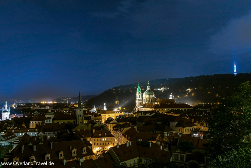 The Petřín lookout tower on the far right, the St. Nicholas Church in the center, and the Old Town tower on the left. Adopted by the Prague Castle