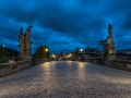 On the Charles Bridge at 6 o\'clock in the morning. In the background the Prague Castle and the St. Vitus Cathedral