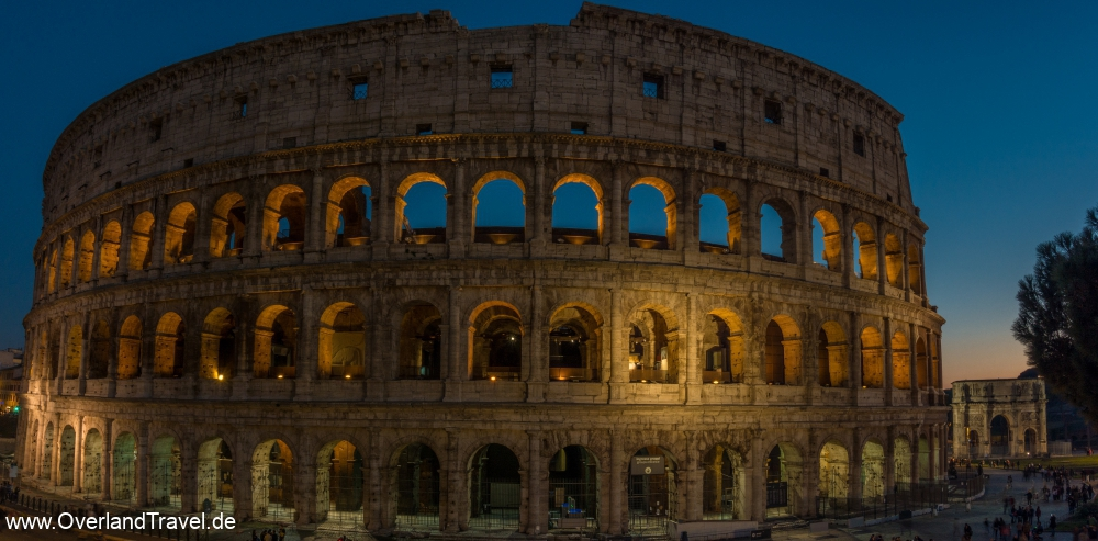 A panorama of the colosseo and the arch constantine after sunset in the blue hour