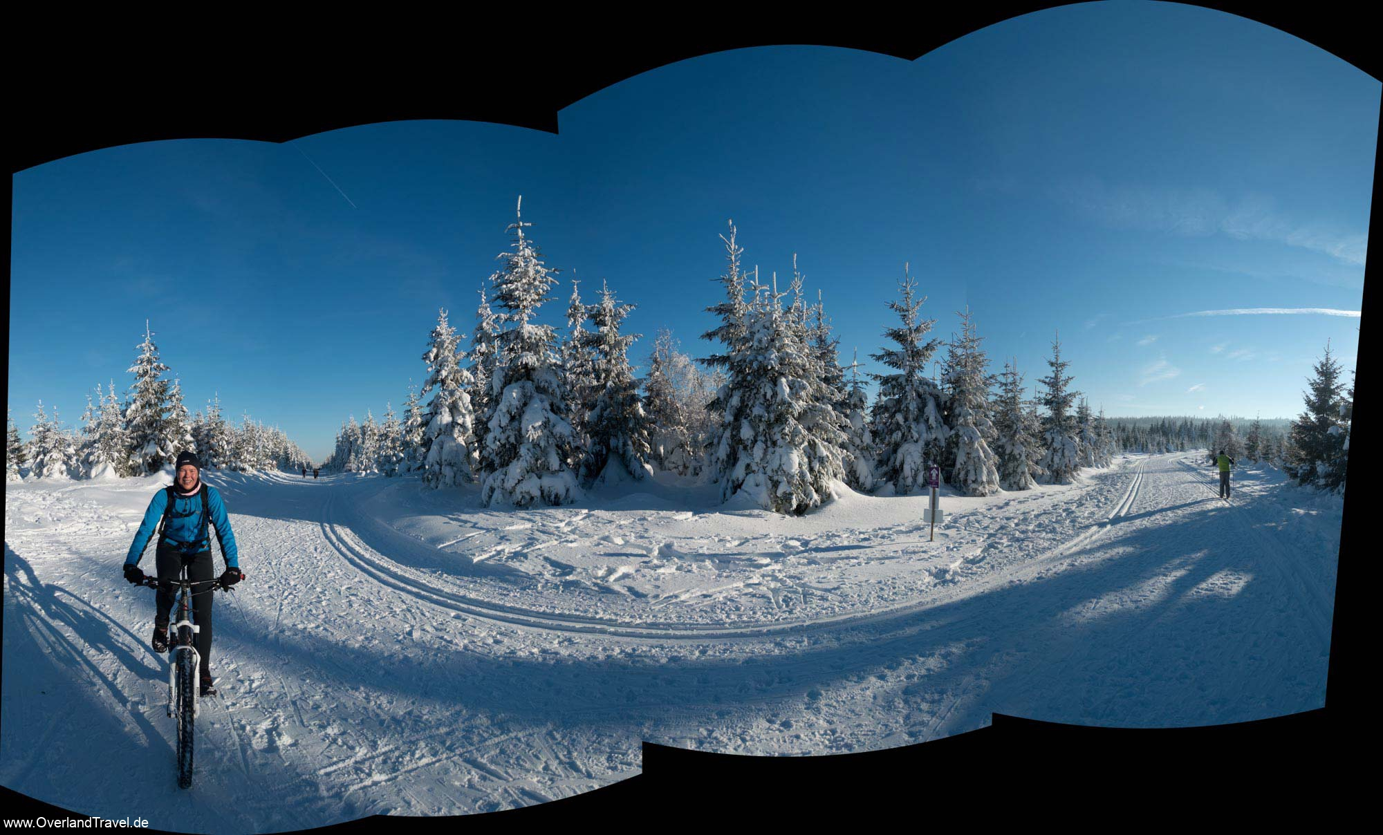 Panorama of Winter Snow mountain biking on a cross country ski track