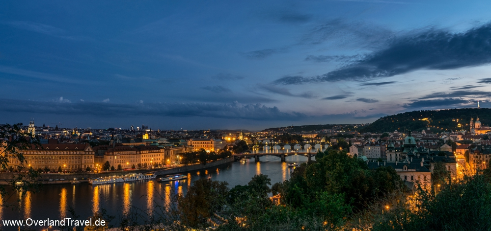 Panoramic view of Prague at the blue hour, the Charles Bridge over the river Vltava