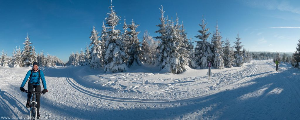 Winter snow mountain biking at cross country ski tracks